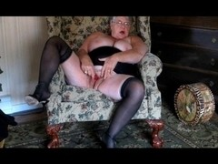 Old whore beating off her gaping twat