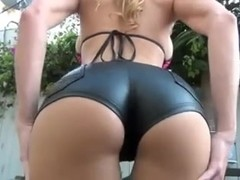 Busty blonde in kinky outfit teases