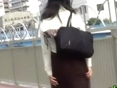 Beautiful Japanese honey getting pulled in hot street sharking
