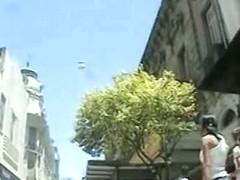 Amazing upskirt shot of a teeny woman on the street
