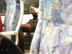 blonde woman with real hot legs touching them