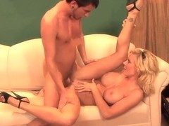 Busty blonde milf Holly Sampson rides on young stud