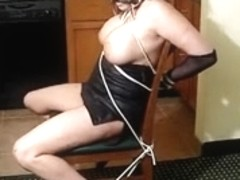 Hawt half-nude women fastened to a chair S&M style