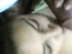 Indian girlfriend licking a huge dark brown cock