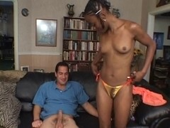 Darksome beauty sucks on a large white knob on the daybed