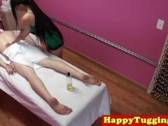 Tattooed asian masseuse jerking