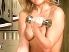 Breasty golden-haired chick does hot striptease during workout