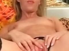 older golden-haired on ottoman masturbates her slit