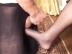 Whore gave this guy a footjob while wearing stockings