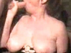 Busty woman takes a portion of amateur cream for her face