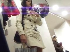 Dark-haired secretary taped on the upskirt video