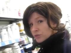 Brunette busty exhibitionist masturbating in public