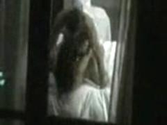 Couple caught fucking through hotel window