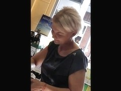 skinny blonde milf in adidas leggings in german supermarket
