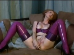 Kendra James has her latex stockings on and masturbating her pussy