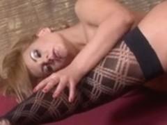 Breasty Dorothy masturbating in nylons