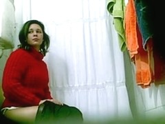 Pretty brunette MILF peeing on the spy camera in a toilet