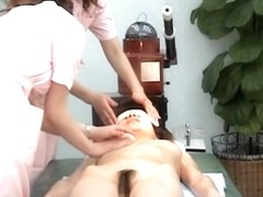 Asian milf is getting an erotic voyeur massage in a hotel
