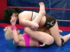 Lucy Belle doing a hard girl fight in the ring