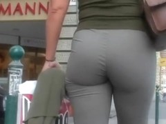 Marvelous MILF in tight shorts walking in upskirt video