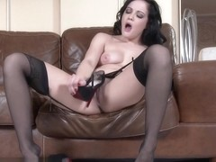 Brunette woman with high sexuality playing with sticky fingers on pussy