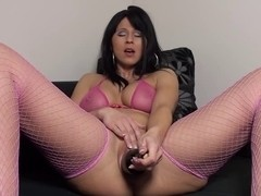 Hottie in fishnets uses a bottle as a sex toy