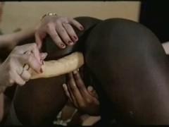 Retro ebony lesbian slut fucked with toys by white girl