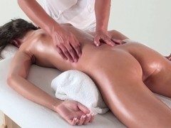 Brunette masturbated by massagist in cute massage video
