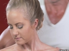 Horny blonde on massage table