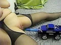 Remote control car and a dildo