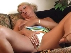Granny Irena gives her old fur pie a admirable fuck with a sex toy