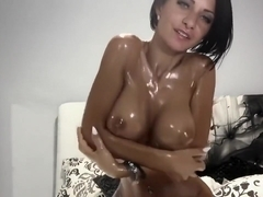 Busty Woman Covers Her Tits With Oil
