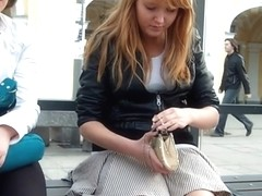 Up skirt video of a cute redhead in pantyhose