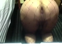 Obese booty in fishnet stockings bends over and rubs her anal opening and her soaked crack