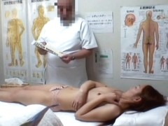 A fresh Asian girl becomes fully naked on the masage table