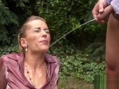 Slut gets peed outdoors