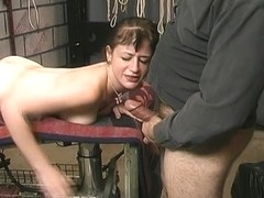 Juvenile brunette hair sadomasochism anguish martyr is made to engulf off Slaver Len's jock