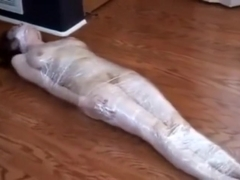 Plasticwrapped mummified girl