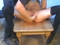 Tied up slave gets whipped by her master in a barn