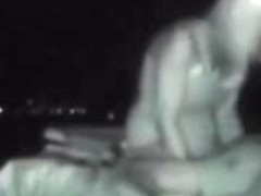 A voyeur films sexy people fucking on the nighttime beach