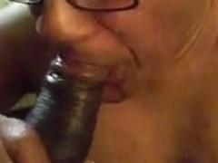 Mature Ebony bitch sucking off a young black dick