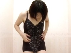 Asian honey tries out new clothes in the dressing room
