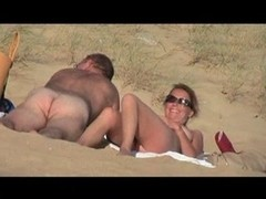 Hot amateurs enjoying sex on a sandy public beach
