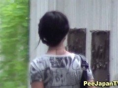 Japanese hottie pisses outdoors
