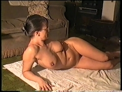 Yvonne opens her legs while oiling her naked body