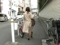 Hot ass shone underneath her coat in this sharking video