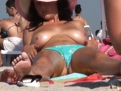 Big boobs rubbed with slippery sun screen