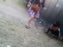 Lots of public pissing at a music festival