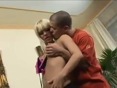 Blonde with silicone tits gets double penetrated