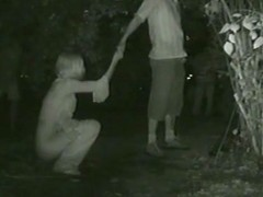 Blonde taking a piss while holding hands with her man